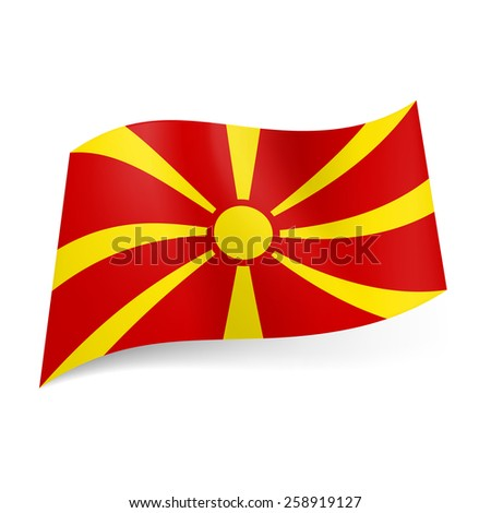 Raster version. National flag of Macedonia: yellow sun on red background  - stock photo