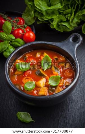 Ratatouille - vegetable stew with basil - stock photo