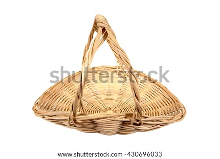 Rattan basket with handle isolated on white background - stock photo