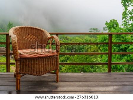 Rattan chair on balcony - stock photo