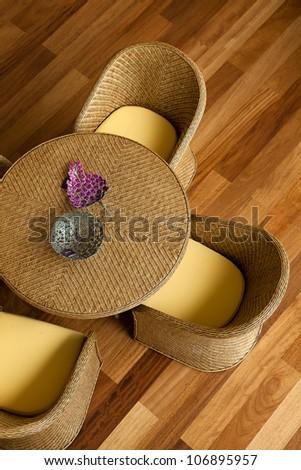 Rattan furniture on wood floor. - stock photo