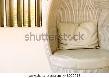 Rattan sofa seat with pillow in hotel or resort - stock photo