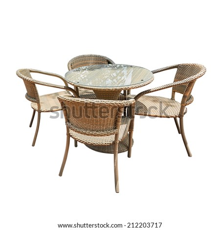 Rattan table and chair isolated on white - stock photo
