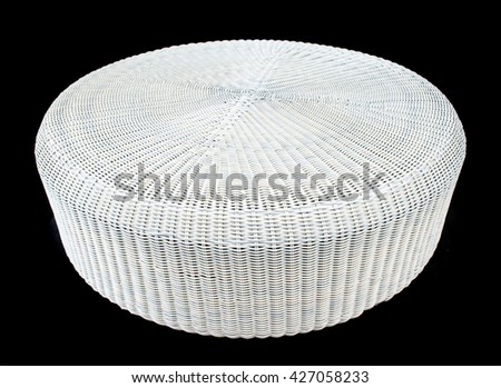 rattan table on black Background - stock photo
