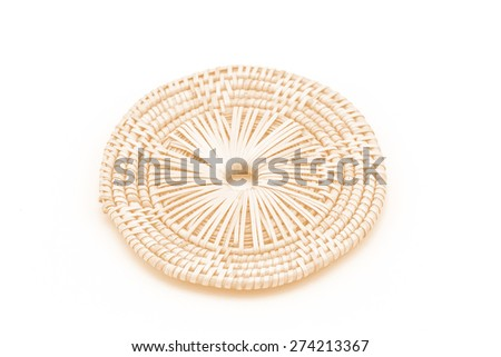 Rattan weave mat on a white background processed in tinted photo in orange tone - stock photo