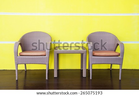 Rattans tables and chairs set on terrace at home  - stock photo