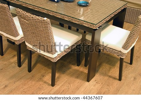 Ratten table and chairs. - stock photo