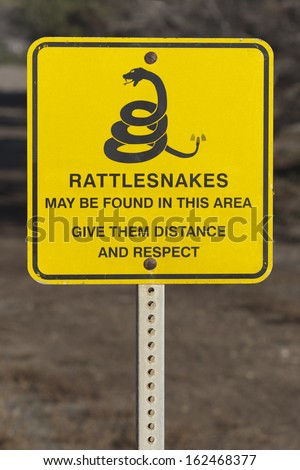 Rattlesnakes warning sign posted inside the park - stock photo
