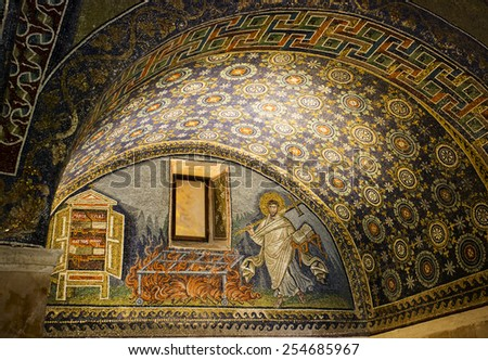RAVENNA, ITALY -SEPTEMBER 6, 2014: Detail of a Byzantine mosaic depicting St. Lawrence carrying the book of Psalms and a cross in the Mausoleum of Galla Placidia, in Ravenna, Italy. - stock photo