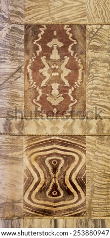 RAVENNA, ITALY - SEPTEMBER 6, 2014: Pieces of marble slabs mirroring vertically and horizontally to create a perfect visual effect.  - stock photo