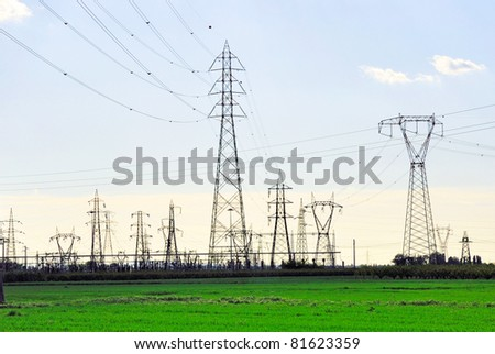 Ravenna, transmission lines at sunset. - stock photo
