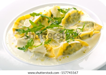 ravioli in creamy blue cheese sauce - stock photo