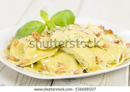 Ravioli - Italian egg and spinach pasta with basil, ricotta and pine ...