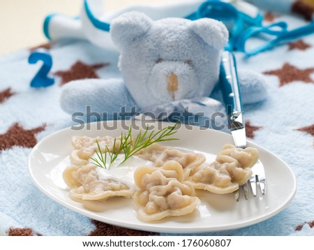 Ravioli pasta stuffed with meat, selective focus. Shot for a story on homemade, organic, healthy baby foods.  - stock photo