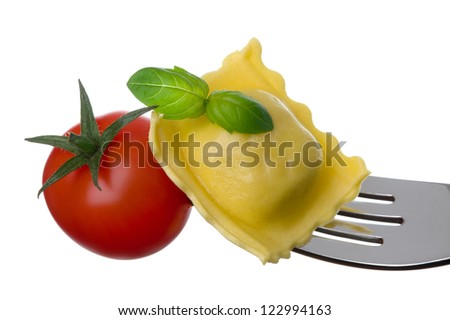 ravioli pasta tomato and basil on a fork against white background - stock photo