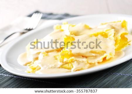 Ravioli with cream - stock photo