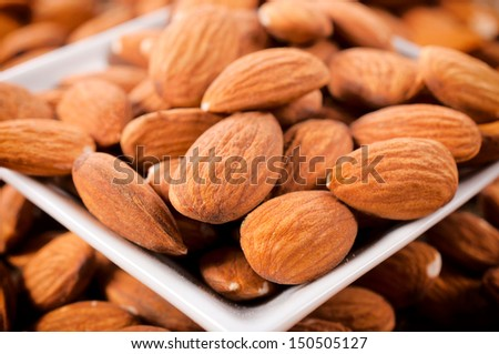 Raw almonds in the cup  - stock photo