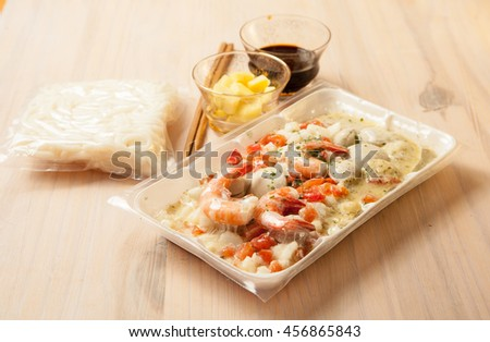 Raw and frozen food for fast and tasty lunch, fusion cuisine  - stock photo