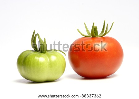 Raw and ripe tomatoes on white - stock photo