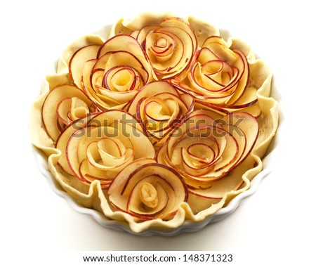 Raw apple pie. Roses made of apple.  - stock photo