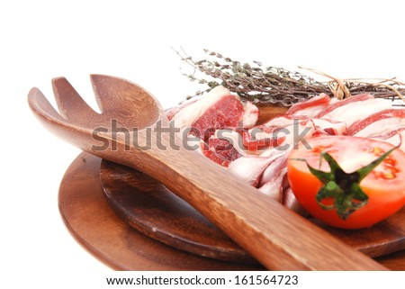raw beef asado ribs with thyme and tomatoes on wooden board isolated over white background - stock photo
