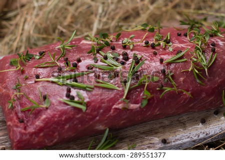 Raw beef marinated in spices. Meat close-up. - stock photo