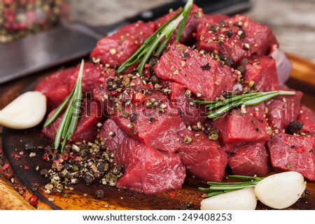 Raw beef meat on a cutting board - stock photo