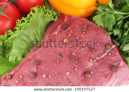 Raw beef meat with vegetables and spices close up - stock photo