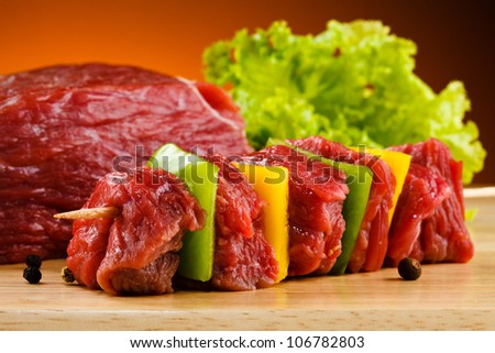 Raw beef on cutting board - stock photo