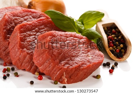 Raw beef on white background - stock photo