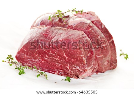 Raw beef roast tied and ready for cooking - stock photo