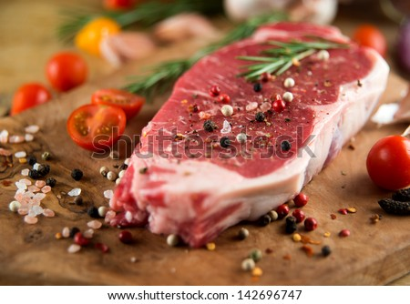 Raw Beef Steak Seasoned and Ready to be Cooked - stock photo