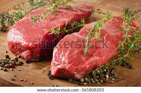 Raw beef steak. Selective focus - stock photo