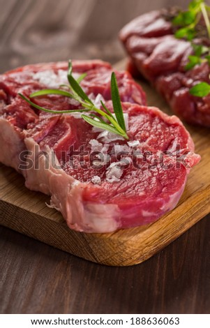 raw beef steaks - stock photo