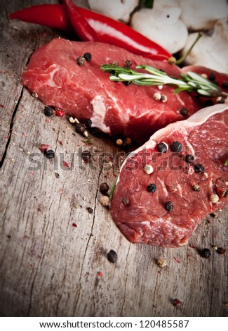 Raw beef steaks prepared for grill - stock photo