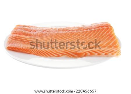 raw big salmon bar on white plate - stock photo