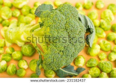 Raw broccoli and brussels sprout on the kitchen table washed and ready for cooking - stock photo