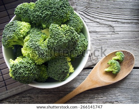 Raw broccoli on wooden background - stock photo