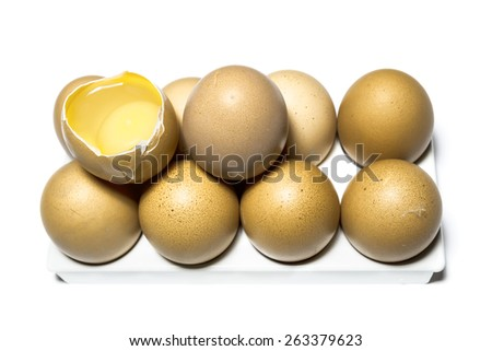 Raw chicken eggs on the base and one egg is broken, isolated on white background - stock photo