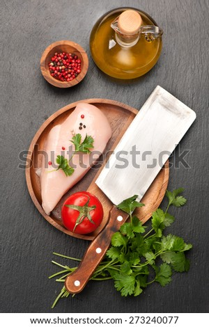 Raw chicken fillet with spices and herbs. top view - stock photo