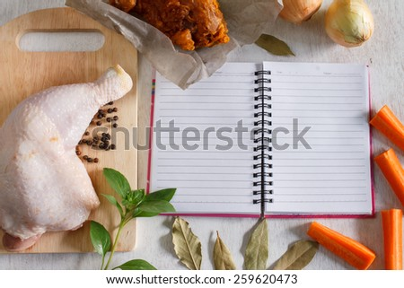 Raw chicken leg with vegetable and spice ingredient for cooking , food background with notepad for copy space, comfort food project or healthy food project - stock photo