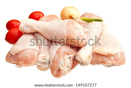 Raw chicken legs with vegetables, isolated on white background  - stock photo