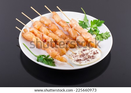 Raw Chicken Skewers On Plate - stock photo