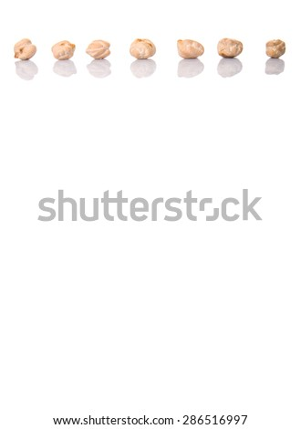Raw chickpeas over white background - stock photo
