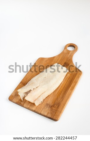 Raw cod fillet on a wooden Board - stock photo