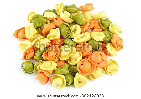 Raw colored tortellini on a white background - stock photo