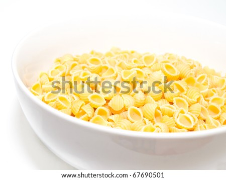 Raw conchigliette in a bowl - stock photo