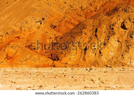 Raw Death Valley Badlands Landscape. Death Valley National Park, California, USA. - stock photo