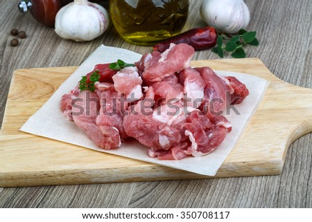Raw Diced pork meat - ready for cooking - stock photo