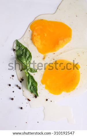 raw eggs on white marble top table with seasoning for cooking, top view